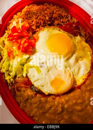 Blue Corn Enchiladas with red chile with egg El Pinto Restaurant and Cantina Albuquerque New Mexico USA - Stock Photo