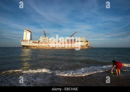 Curious view of the boats moored on the beach sand El Saler Valencia Spain Europe - Stock Photo