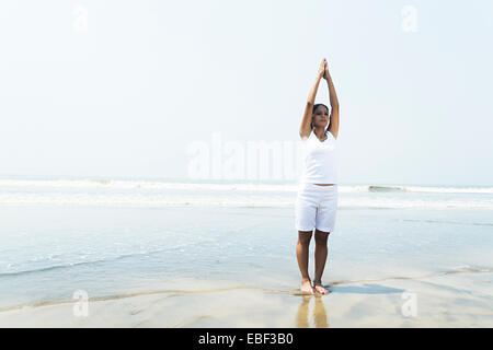 indian lady beach Yoga - Stock Photo
