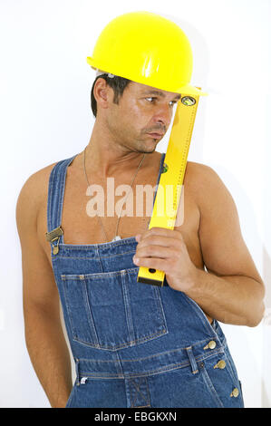 workman with hardhat and level - Stock Photo