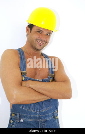 workman with overalls and hardhat - Stock Photo