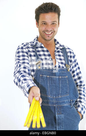 workman with overalls and pocket rule - Stock Photo