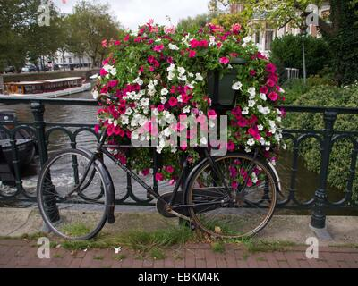Bicycle parked at the bridge in Amsterdam - Stock Photo