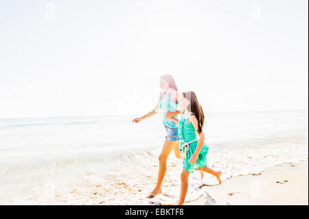 USA, Florida, Jupiter, Mom and daughter (6-7) spending time together on beach - Stock Photo