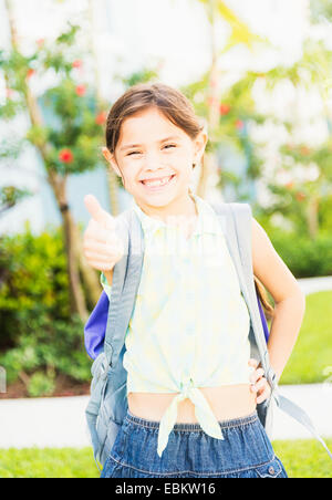 USA, Florida, Jupiter, Portrait of girl (6-7) with thumbs up - Stock Photo