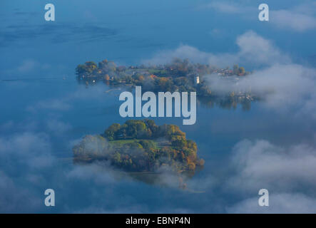 aerial view through clouds to Fraueninsel and Krautinsel, Germany, Bavaria, Lake Chiemsee - Stock Photo