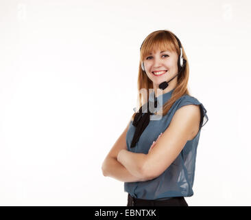 young beautiful business woman in blue blouse with headphones - Stock Photo