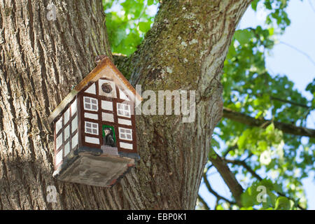 nesting box looking like a timbered house, Germany - Stock Photo