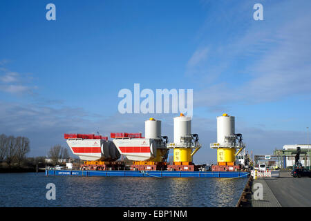 components for offshore wind farm in harbour, Germany, Bremerhaven - Stock Photo