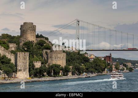 Rumeli Hisari (Fortress of Europe) and Fatih Sultan Mehmet Suspension Bridge, Hisarustu, Bosphorus Strait, Istanbul, - Stock Photo