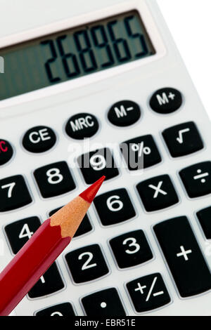 red pencil and a calculator. image icon for streamline and economize - Stock Photo
