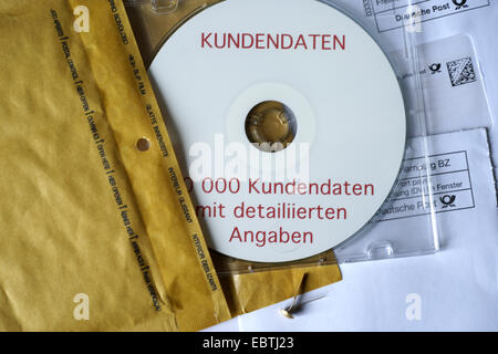 DVD with customer data of a bank - Stock Photo