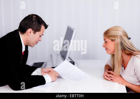 man an woman talking in an office - Stock Photo