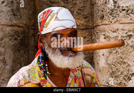 old man with long cigar and scarf in Old Havana, Cuba, La Habana - Stock Photo