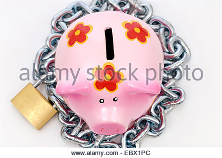 piggy bank with safety lock - Stock Photo