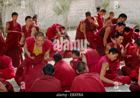 Monks debate the finer points of Tibetan Buddhism in this historical form of learning at Sera Monastery, China, - Stock Photo