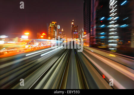 Dubai Metro by night - Stock Photo