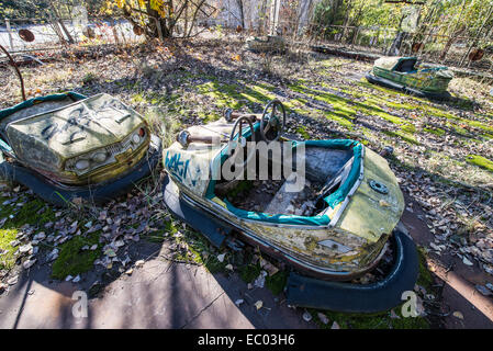 Bumper cars in funfair in city park of Pripyat abandoned city, Chernobyl Exclusion Zone, Ukraine - Stock Photo