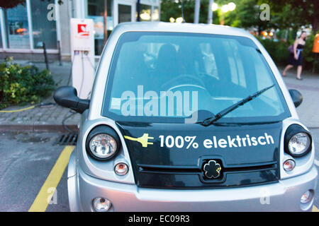 Electric car at charging station in Berlin. - Stock Photo