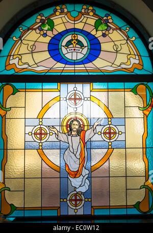 Stained glass window in Mor Ignatius Jacobite Syrian Orthodox Church at Jebel Ali in Dubai United Arab Emirates - Stock Photo