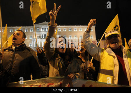 Athens, Greece. 7th Dec, 2014. Protesters shout slogans during a parliament meeting for a vote on the country's - Stock Photo