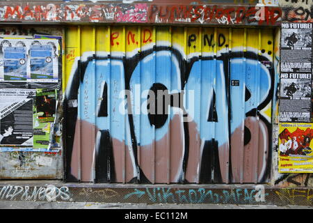 Exarchi, Greece. 7th Dec, 2014. An ACAB (all Cops are Bastards) graffiti on the shutters of a shop in Exarchia Square. - Stock Photo