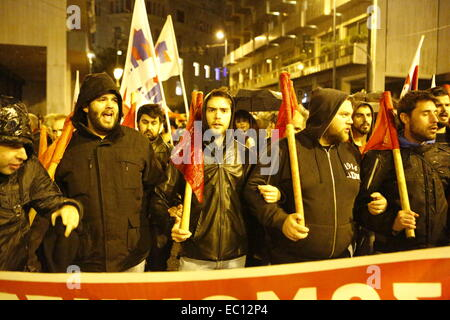 Athens, Greece. 7th Dec, 2014. Protesters from the PAME (All-Workers Militant Front) trade union march form a human - Stock Photo