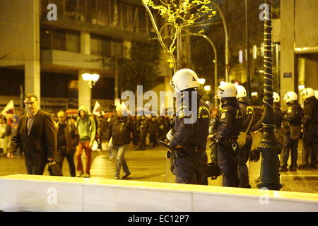 Athens, Greece. 7th Dec, 2014. Riot police officers watch the protesters from the PAME (All-Workers Militant Front) - Stock Photo