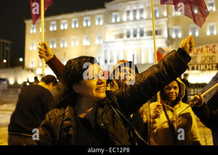 Athens, Greece. 7th Dec, 2014. One of the laid-off government cleaners shouts slogans towards the Greek Parliament. - Stock Photo