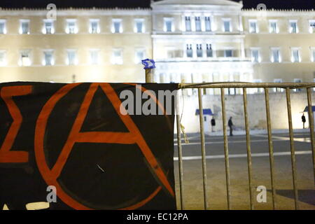 Athens, Greece. 7th Dec, 2014. A banner with a large A for Anarchy hangs outside the Greek Parliament. Greek protesters - Stock Photo