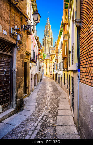 Toledo, Spain alleyway towards Toledo Cathedral. - Stock Photo