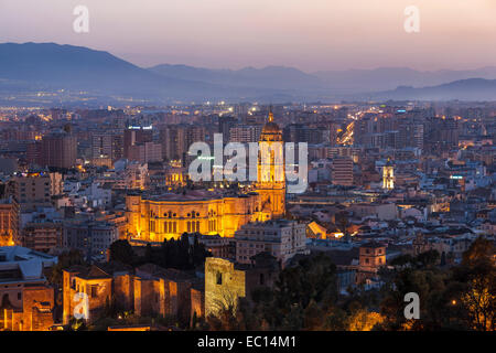Malaga Spain Old Town with Cathedral scenic overview from Gibralfaro with the Alcazaba at sunset twilight dusk evening - Stock Photo