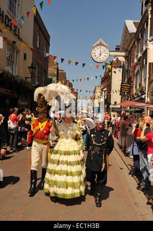 Dickens Festival grand parade, Rochester, Kent. Lady in red dress with officer, on Rochester high Street beneath - Stock Photo