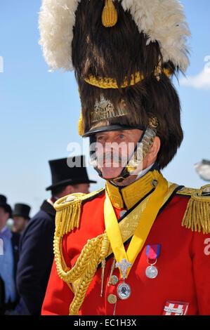 Dickens Festival grand parade, Rochester, Kent.  Officer in uniform and plumed helmet, on Esplanade beneath Rochester - Stock Photo