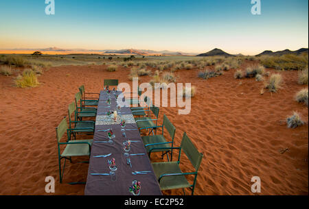 Africa, Namibia. Tok Tokkie Trails. Dinner table at the campsite. - Stock Photo