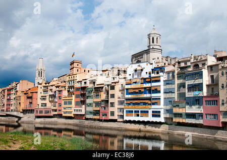 Girona houses hanging over Onyar River ( cathedral and belltower of Sant Feliu church  ) Girona Catalonia Spain - Stock Photo