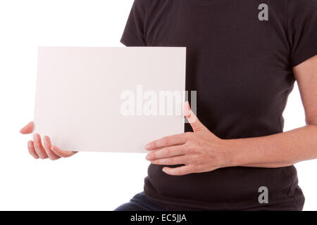 A young woman is holding a blackboard in her hands - Stock Photo