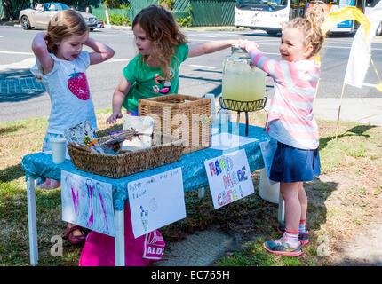 Children selling lemonade outside a polling booth, Melbourne, Australia - Stock Photo