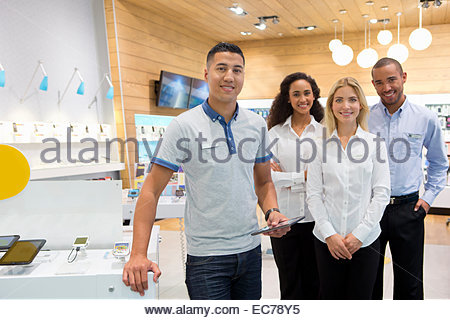 Sales team in phone store - Stock Photo