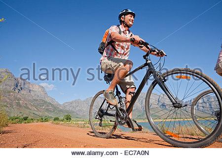 Man mountain biking in countryside - Stock Photo