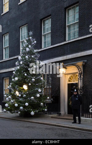 London, UK. 10 December 2014. A Christmas tree with baubles is lit outside No. 10 Downing Street, London. Credit: - Stock Photo