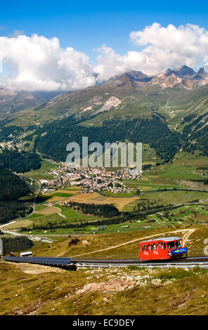 Cable car going up Muottas Muragl with the Upper Engadin Lakes in the background, Engadin, Switzerland Standseilbahn - Stock Photo