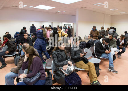Asylum seekers wait inside the Berlin Central Reception Facility for Asylum Seekers to apply for refugee status, - Stock Photo