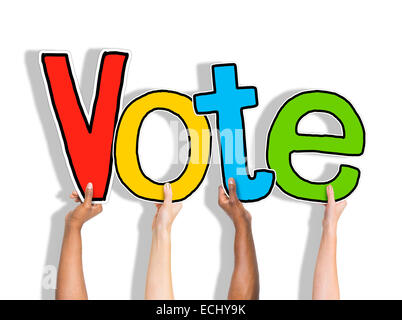Diverse Hands Holding the Word Vote - Stock Photo
