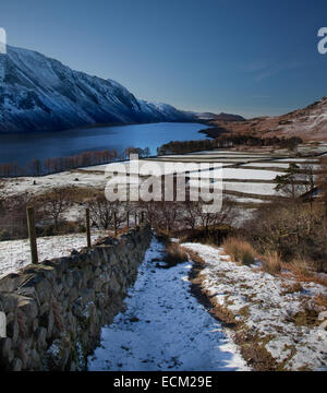 From Yewbarrow in snow towards WastWater Screes - Stock Photo