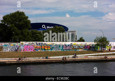 The East Side Gallery and O2 World arena seen from the Spree River. - Stock Photo