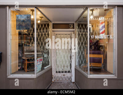 A traditional barber shop with antique furniture in the window. Downtown, Brampton, Ontario, Canada. - Stock Photo