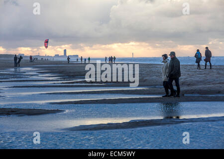 North Sea beach, stormy sea, clouds mountains, during an autumn storm, people on the beach, - Stock Photo