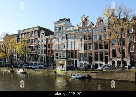 Brickwork houses by the Singel canal in Amsterdam, the Netherlands. - Stock Photo