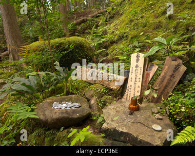 Offerings at shirine along the Kumano Kodo Pilgrimage Route near Waroda-ishe Rock, Kii Peninsula, Wakayama Prefecture, - Stock Photo